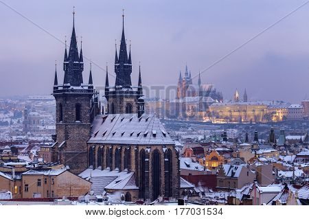 Winter in Prague - city panorama with Tyn Cathedral and St. Vitus Cathedral. Prague Bohemia Czech Republic.