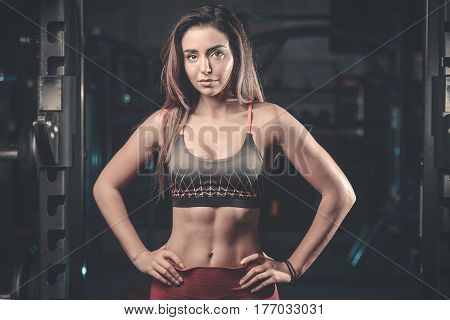 Caucasian Sexy Fitness Female Model In Gym Close Up Abs.