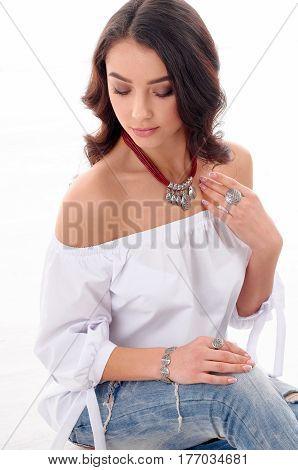 Portrait of gorgeous woman model wearing beautiful jewellery