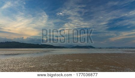 A cloudy blue evening sky looking out over the south China sea in Vung Lam Bay Vietnam.