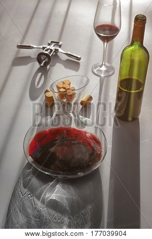 Red wine in decanter, glass and bottle on table