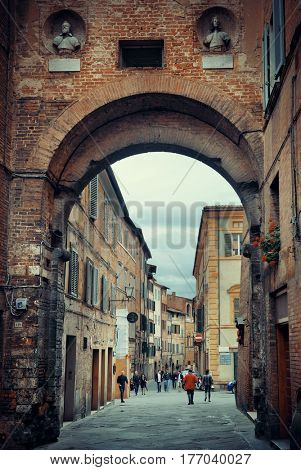 SIENA - MAY 13: A typical street view on May 13, 2016 in Siena, Italy. Siena is known for its stylish cuisine, art, museums, medieval cityscape.