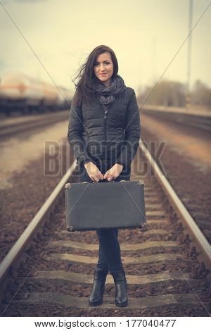 Young Woman On Railway Tracks