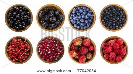 Black-blue and red berries. Collage of different fruits and berries isolated on white. Blueberries, blackberries, cherries, strawberries currants and raspberries. Collection of fruits and berries in a bowl. Top view.