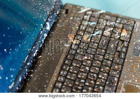 the computer in the spattered oil paint. artist computer.