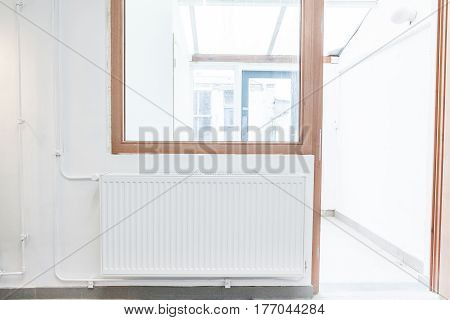 on concrete wall hang an radiator in working in the wall