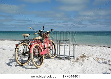 two bicycles on the beach summertime fun
