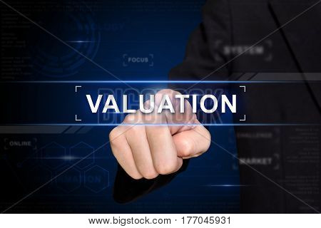 business hand clicking valuation button on virtual screen