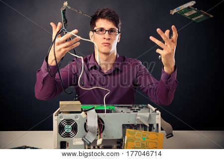 confused nerd with lots of computer hardware