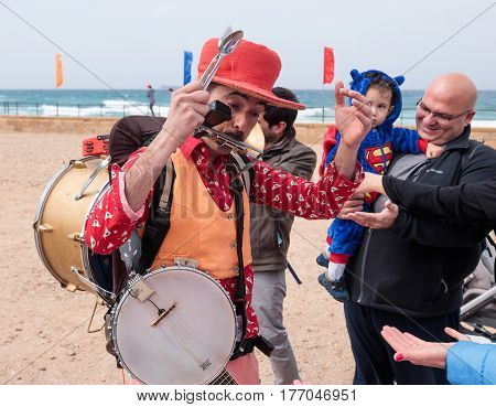 Participants Of Festival Plays Musical Instruments And Shows His Art