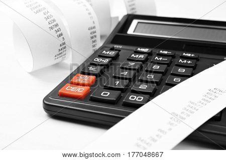 Calculator with adding machine tape, closeup
