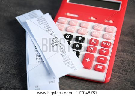 Tax bills and red calculator on grange background