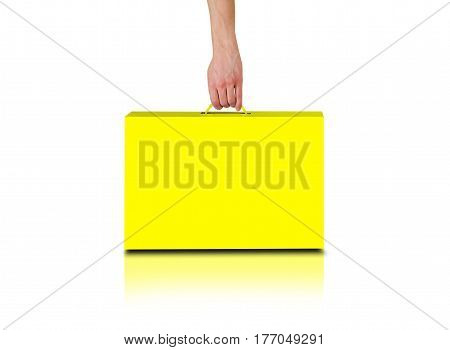 Hand Holds A Yellow Box With A Handle. Packing Box For Laptop. Stands On A Reflection Floor. Isolate