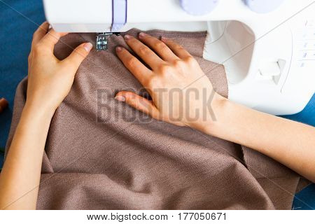 Woman Tailor Working On Sewing Machine. Hands. Close Up. Tailoring. Details.