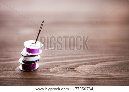 Tailor. Close Up Of Sewing Items On Wood Background