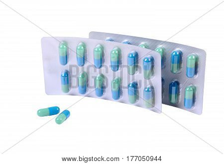 Capsules and two pills container isolated on white