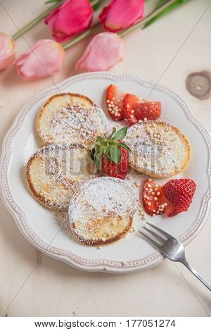 home made breakfast with fresh strawberries on a plate