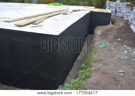 Waterproofing foundation bitumen. Foundation Waterproofing Damp proofing Coatings.Waterproofing house foundation with spray on tar. Construction techniques for waterproofing basement and foundations