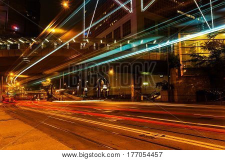 night street with light trails of traffic in Hongkong Central