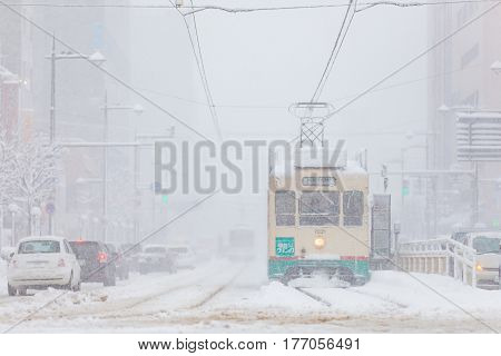 Toyama Japan - Jan 24 : Toyama Railway and Toyama city in snow day on JAN 24 2016 in Toyama Japan. Toyama Regional Railway is a transportation company in Toyama Toyama Japan. The company is commonly known as Chitetsu