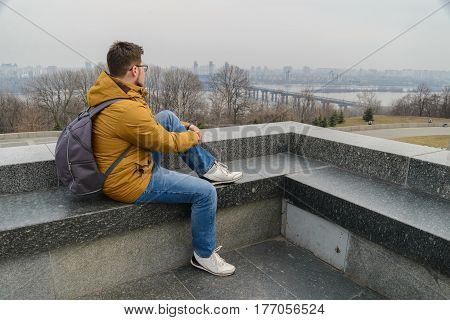 young man looking on a city in cold day
