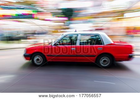 Hongkong Taxi On The Road In Motion Blur