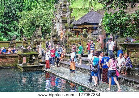 Bali,Indonesia-May 29,2010:Group of tourist visiting the Tirta Empul Temple Bali,Indonesia on 29th May 2010.Tirta Empul Holy Water Temple is a very popular destination in Ubud,Bali,Indonesia