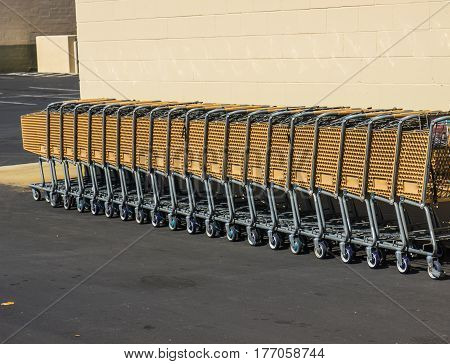 Row Of Shopping Carts Stacked Together In Parking Lot