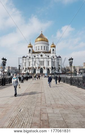 Moscow, Russia - 18 March 2017: People Walking At The Brige Near The Cathedral Of Christ The Saviour