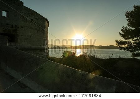 Sunset on Fort Balaguier on the Mediterranean sea Saint Mandrier district in the city of Toulon on the French riviera. Fort Balaguier was built to protect the entrance of Toulon Roadstead