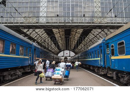 LVIV UKRAINE - AUGUST 21 2015: People getting prepared to board a train on the platforms of Lviv train station