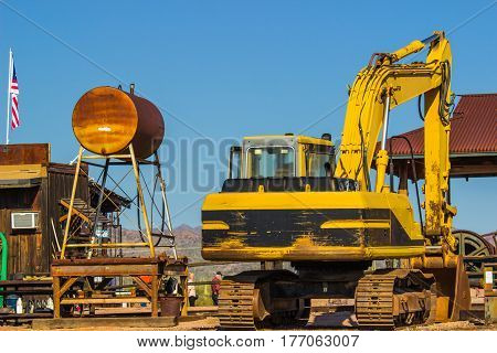 Rusty Water Tank & Rear Of Bulldozer