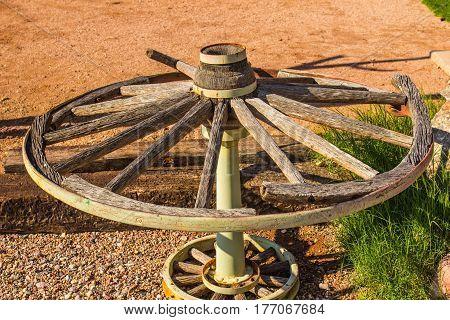 Old Broken Wooden Spoke Wagon Wheel On Display