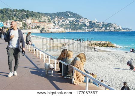 Nice, France - 25 February, People on the sunny embankment, 25 February, 2017. People and tourists having a rest on the Cote d'Azur.
