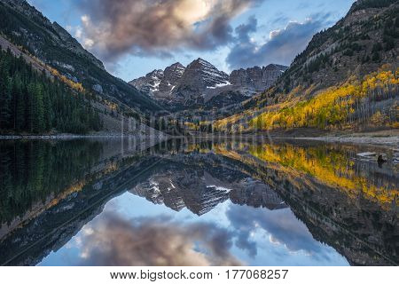 Maroon Bells and the reflection cloud. Long exposure photo.