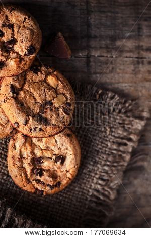 Chocolate chip cookies freshly baked on rustic wooden table. Selective Focus. Copy space.