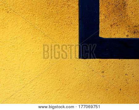 Yellow and Orange speckled wall with a black right angle and space for text.
