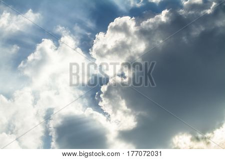 Dramatic backlit clouds with very blue sky