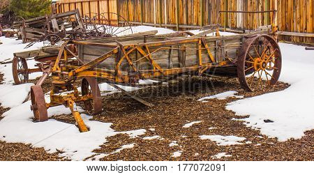 Vintage Wooden Wagon With Large Iron Wheels On Display In Winter
