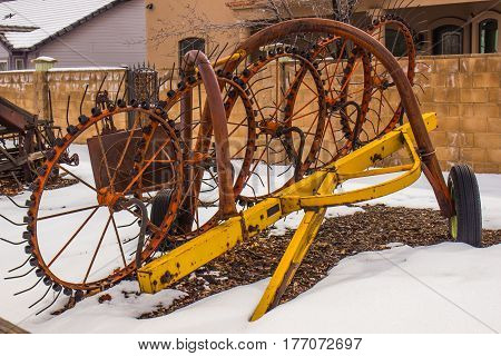 Vintage Farming Equipment Stored In Winter Snow