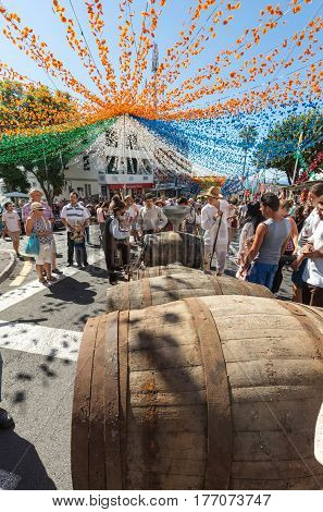 ESTREITO DE CAMARA DE LOBOS PORTUGAL - SEPTEMBER 10 2016: Street Decoration at Madeira Wine Festival in Estreito de Camara de Lobos Madeira Portugal. The Madeira Wine Festival honors the grape harvest with a celebration of traditional local heritage and w