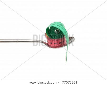 Diet concept. spoon and measuring tapes isolated on white background