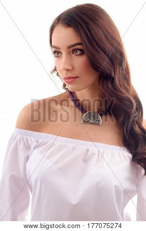 A beautiful young woman model with long brown hair fresh skin wearing accessories and jewelry isolated over white background