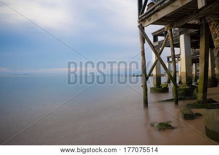 coast of blue sea with black bunting