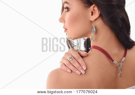 fashion young girl with long brown hair fresh skin wearing accessories and jewelry isolated over white background