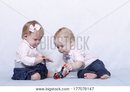 Funny infant kids playing in kindergarden. Horizontal shot. Copy space