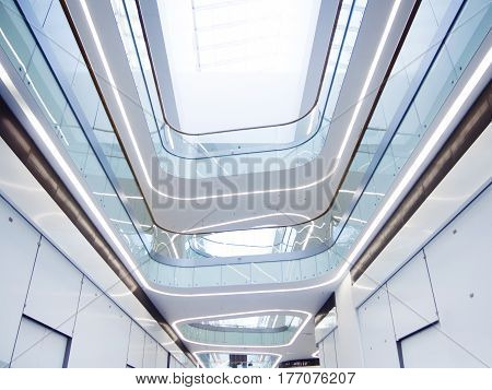look on the bright atrium of a modern commercial or business center, glass, metal, modern construction technology