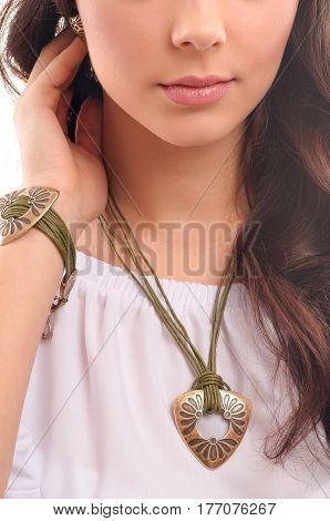 Beautiful woman showing off her jewellery in fashion concept isolated over white background