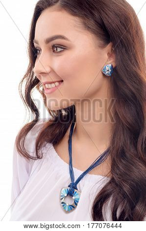 Young Girl model showing off her jewellery in fashion concept wearing accessories and jewelry isolated over white background