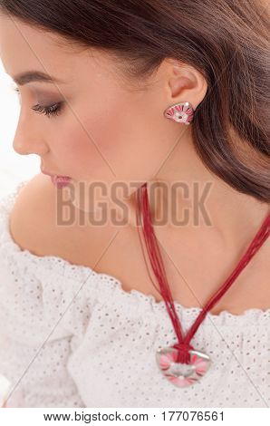 Nice woman showing off her jewellery in fashion concept wearing accessories and jewelry isolated over white background
